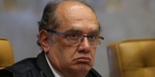 Supreme Court Judge Gilmar Mendes attends an ordinary session of the Supreme Court in Brasilia, Brazil, Thursday, Aug. 13, 2015. The Supreme Court is debating on the decriminalization of drug possession for personal use. (AP Photo/Eraldo Peres)