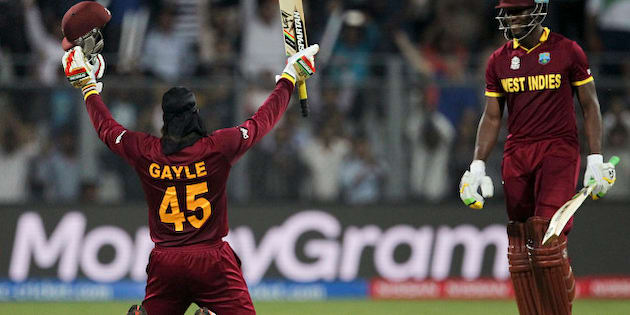 West Indies' Chris Gayle raises his bat after scoring hundred runs against England during their ICC World Twenty20 2016 cricket match at the Wankhede stadium in Mumbai, India, Wednesday, March 16, 2016. (AP Photo/Rafiq Maqbool)
