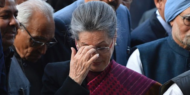 President of India's Congress Party Sonia Gandhi gestures as she arrives for a media briefing inside All India Congress Committee (AICC) headquarters in New Delhi on December 19, 2015, after a court appearance by her and Rahul Gandhi.  An Indian court granted bail to opposition leaders Sonia and Rahul Gandhi minutes after they arrived at a Delhi court, over allegations they illegally acquired a newspaper's assets. AFP PHOTO / CHANDAN KHANNA / AFP / Chandan Khanna        (Photo credit should read CHANDAN KHANNA/AFP/Getty Images)