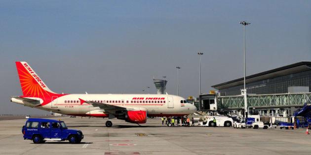 HYDERABAD, INDIA - DECEMBER 19: Air India aircraft at Hyderabad Airport on December 19, 2012 in Hyderabad, India. (Photo by Priyanka Parashar/Hindustan Times via Getty Images)