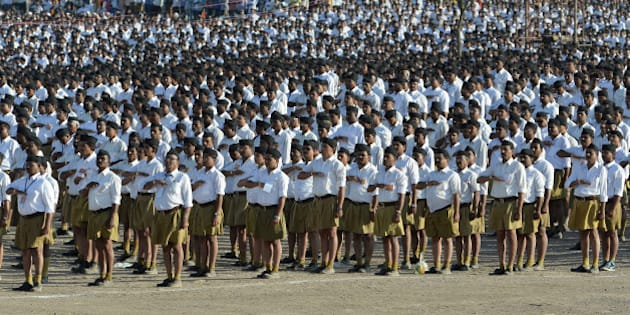 Indian right wing Rashtriya Swayamsevak Sangh (RSS) volunteers give a traditional salute at a rally in Pune some 135 kms from Mumbai on January 3, 2016.  Over 150,000 RSS voluntreers are attending a day long congregation'Shivashakti Sangam', the largest in recent years. AFP PHOTO/ INDRANIL MUKHERJEE / AFP / INDRANIL MUKHERJEE        (Photo credit should read INDRANIL MUKHERJEE/AFP/Getty Images)