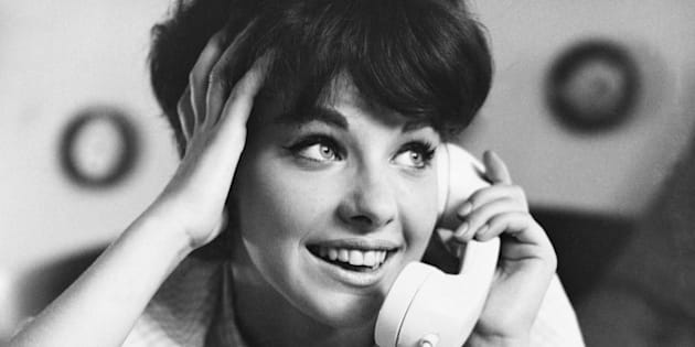 Sixteen-year-old girl, Michelle Tuttle, talking on the phone. Photographed in 1964.