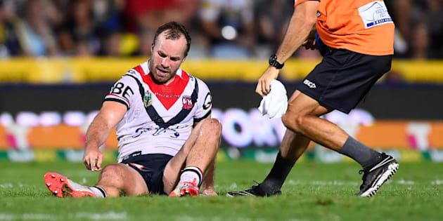 TOWNSVILLE, AUSTRALIA - MARCH 17:  Ian Henderson of the Roosters points to his lower leg after being injured during the round three NRL match between the North Queensland Cowboys and the Sydney Roosters at 1300SMILES Stadium on March 17, 2016 in Townsville, Australia.  (Photo by Ian Hitchcock/Getty Images)