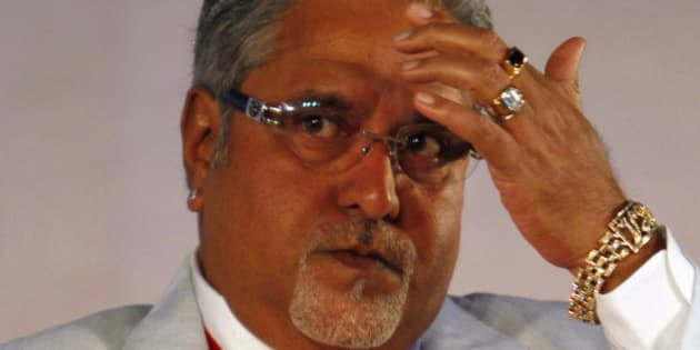 United Breweries Group Chairman Vijay Mallya looks on during the Global Investors Meet organized by the Karnataka state government in Bangalore, India, Thursday, June 3, 2010. The southern state which is home to India's Silicon Valley aims to attract business investment with this two day event that began Thursday. (AP Photo/Aijaz Rahi)