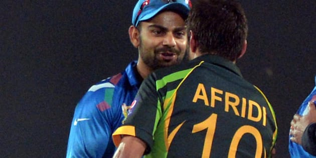 Indian captain Virat Kohli (L) congratulates Pakistani batsman Shahid Afridi for their team's win during the sixth match of the Asia Cup one-day cricket tournament between India and Pakistan at the Sher-e-Bangla National Cricket Stadium in Dhaka on March 2, 2014. AFP PHOTO/Dibyangshu SARKAR        (Photo credit should read DIBYANGSHU SARKAR/AFP/Getty Images)