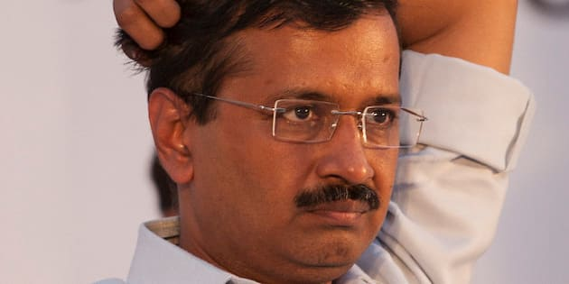 Delhi state Chief Minister Arvind Kejriwal and leader of Aam Aadmi Party, or Common Man's Party attends a public meeting to mark the party's 100 days government in the capital, in New Delhi, India, Monday, May 25, 2015. (AP Photo/Tsering Topgyal)