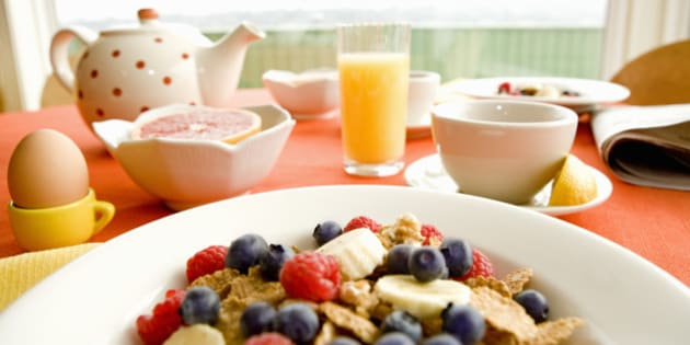 Healthy breakfast of dry cereal and fruit with egg and juice