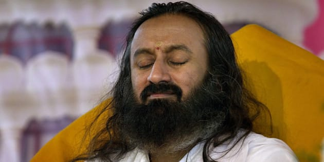 Founder of Art of Living Foundation Sri Sri Ravi Shankar meditates during a three-day 'Knowledge, Meditation and Yoga' camp for village heads of the southern Indian state of Karnataka at their International Center, 25 kilometers (16 miles) south of Bangalore, India, Tuesday, Aug. 29, 2006. The Art of Living provides intensive course on lowering stress and finding renewed vigor and clarity through age-old Hindu breathing techniques, with more than 2 million people taking the course based on the teachings of Shankar. (AP Photo/Aijaz Rahi)