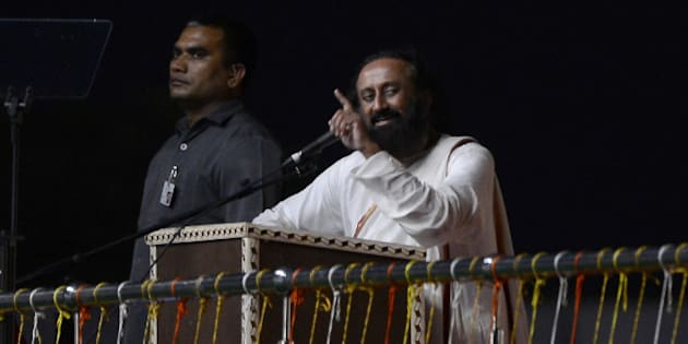 Spiritual leader Sri Sri Ravi Shankar speaks on the first day of the three-day World Culture Festival in New Delhi on March 11, 2016. 