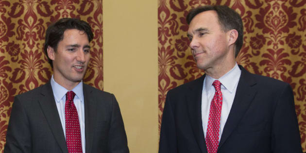 Scott Brison, finance spokesperson of the Liberal Party of Canada, from left, Justin Trudeau, leader of the Liberal Party of Canada, and Liberal candidate Bill Morneau speak at the Canadian Club of Toronto in Toronto, Ontario, Canada, on Monday, May 11, 2015. Trudeau, preparing for elections this year on a platform of combating income inequality, said he'd raise taxes on the highest-earning Canadians while cutting them for everyone else. Photographer: Kevin Van Paassen/Bloomberg via Getty Images