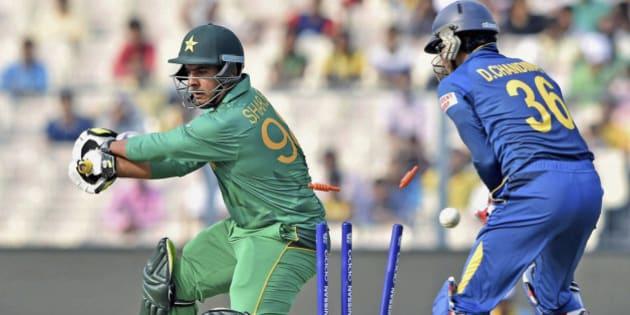 Pakistani batsman Sharjeel Khan is clean bowled during the ICC World Twenty20 2016 cricket warm up match at the Eden Garden in Kolkata, India, Monday, March 14, 2016. (Swapan Mahapatra/Press Trust of India via AP)
