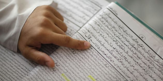 **  PAKISTAN ESCUELAS RADICALES  **  This Nov. 5, 2009 photo shows a student reading a book written in Urdu, during a class at a madrassa, or Islamic school, in Karachi, Pakistan. Muslims from around the globe are traveling to Pakistan to attend conservative Islamic schools despite a government ban, raising fears the country is exporting extremism and showing how resistant the colleges are to oversight by authorities. (AP Photo/Alexandre Meneghini)