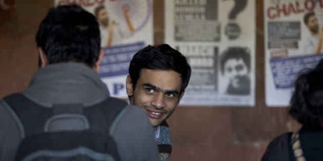 Umar Khalid, a student leader of Jawaharlal Nehru University (JNU) appears at the campus, along with four others, not in photo, who face charges of sedition, in New Delhi, India, Monday, Feb. 22, 2016. Khalid and four other students went underground after a program earlier in the month at the university in the favor to mark the anniversary of the 2013 execution of Afzal Guru, a Kashmiri man convicted of an attack on India's Parliament. (AP Photo/Manish Swarup)
