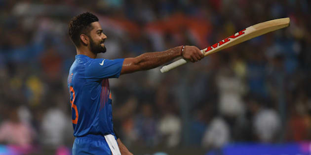 India's Virat Kohli celebrates after victory in the World T20 cricket tournament match between India and Pakistan at The Eden Gardens Cricket Stadium in Kolkata on March 19, 2016. / AFP / Prakash SINGH        (Photo credit should read PRAKASH SINGH/AFP/Getty Images)