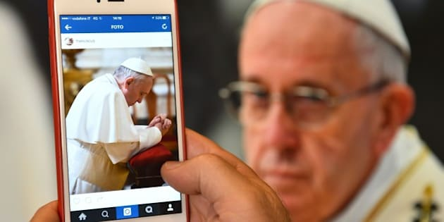 A man looks at the Instagram account of Pope Francis (Franciscus) on March 19, 2016 in Rome. The date for the pontiff's debut on the celebrity-dominated social medium was chosen by the 79-year-old himself as it marks the third anniversary of his inauguration as the leader of the world's 1.2 billion Catholics. / AFP / GABRIEL BOUYS        (Photo credit should read GABRIEL BOUYS/AFP/Getty Images)