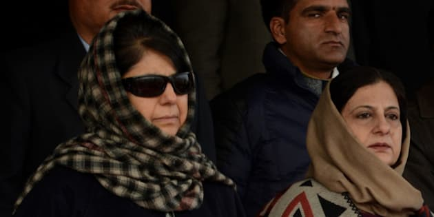 Peoples Democratic Party (PDP) president Mehbooba Mufti (L) looks on during celebrations marking India's Republic Day at Bakshi Stadium in Srinagar on January 26, 2016. The anniversary of the partition of the sub-continent in 1947 is often a tense period in Kashmir, a picturesque Himalayan territory which has been divided between India and Pakistan since the end of British colonial rule. AFP PHOTO / TAUSEEF MUSTAFA / AFP / TAUSEEF MUSTAFA        (Photo credit should read TAUSEEF MUSTAFA/AFP/Getty Images)