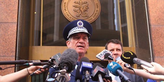 SYDNEY, AUSTRALIA - DECEMBER 15:  NSW Police Commissioner Andrew Scipione talks to the media outside the Lindt Cafe in Martin Place on December 15, 2015 in Sydney, Australia. Today marks the first anniversary of the deaths Katrina Dawson and Tori Johnson, who were killed along with the gunman following a 17-hour siege at the cafe in 2014.  (Photo by Matt Blyth/Getty Images)