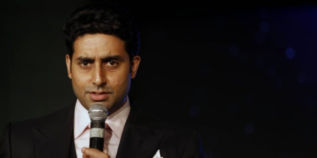 Bollywood actor Abhishek Bachchan talks during the awarding ceremony for the Green Globe Award trophy for outstanding contribution by a celebrity during the Delhi Sustainable Development Summit in New Delhi, India, Thursday, Feb. 2, 2012.   (AP Photo/Tsering Topgyal)