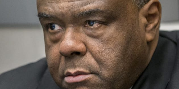 Jean-Pierre Bemba takes his seat in the court room of the International Criminal Court in The Hague, Netherlands, Monday, March 21, 2016. The International Criminal Court is passing judgment on former Congolese vice president Bemba on charges of commanding a militia that went on a spree of murder, rape and pillage in Central African Republic more than a decade ago. The verdicts being delivered Monday afternoon focus on the responsibility of a military commander for the actions of his troops. Bemba's long-running trial also was the first at the ICC to feature allegations of systematic sexual abuse by soldiers in a conflict. (AP Photo/Jerry Lampen, Pool)
