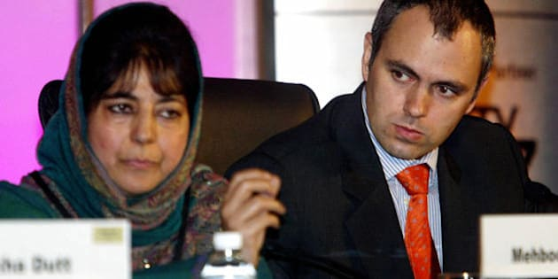 NEW DELHI, INDIA:  Chairperson of the Jammu and Kashmir People's Democratic Party (PDP), Mehbooba Mufti (L) answers a question as President of the National Conference of Jammu and Kashmir, Omar Abdullah looks on during the third annual Hindustan Times Leadership Summit in New Delhi, 16 November 2005.  The two-day long Hindustan Times Leadership Initiative is attended by key political and business leaders from both India and overseas, with the aim of discussing the changing dynamics between India and the world on social, economic and political issues. AFP PHOTO/RAVEENDRAN  (Photo credit should read RAVEENDRAN/AFP/Getty Images)