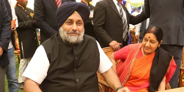 NEW DELHI, INDIA - FEBRUARY 23: Punjab Deputy Chief Minister Sukhbir Singh Badal and External Affairs Minister Sushma Swaraj during a lunch party for the political and media fraternity hosted by Union Minister of Food Processing Industries Harsimrat Kaur Badal and her husband and Punjab Deputy Chief Minister Sukhbir Singh Badal, on February 23, 2016 in New Delhi, India. Eminent personalities from the Indian social circuit were present at the do and were seen indulging in discussions about the current state of affairs. (Photo by Prabhas Roy/Hindustan Times via Getty Images)
