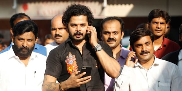 NEW DELHI, INDIA - JULY 25: Former Rajasthan Royals player S. Sreesanth comes out of Patiala House Court after the court exonerated suspended Indian cricketers S. Sreesanth, Ajit Chandila, Ankeet Chavan and others from the Indian Premier League 2013 spot-fixing scandal and cheating charges levelled upon them by Special Cell Delhi Police, on July 25, 2015 in New Delhi, India. MCOCA court has acquitted Sreesanth and two other accused cricketers in IPL spot fixing scandal. The entire case has been dropped due to lack of evidence. (Photo by Ravi Choudhary/Hindustan Times via Getty Images)