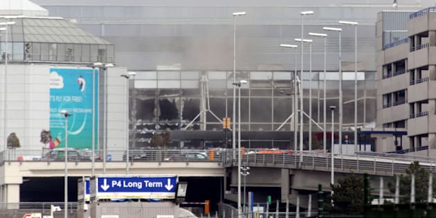 BRUSSELS, BELGIUM - MARCH 22:  A plume of smoke rises over Brussels airport after the controlled explosion of a third device in Zaventem Bruxelles International Airport after a terrorist attack on March 22, 2016 in Brussels, Belgium. At least 31 people are thought to have been killed after Brussels airport and a Metro station were targeted by explosions. The attacks come just days after a key suspect in the Paris attacks, Salah Abdeslam, was captured in Brussels. (Photo by Sylvain Lefevre/Getty Images)