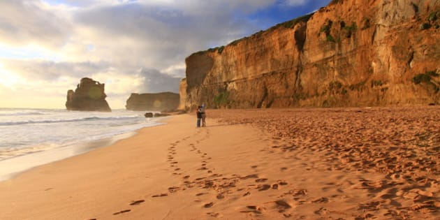 [UNVERIFIED CONTENT] took in Great Ocean Road, a couple are taking photo in the beach near sunset time.