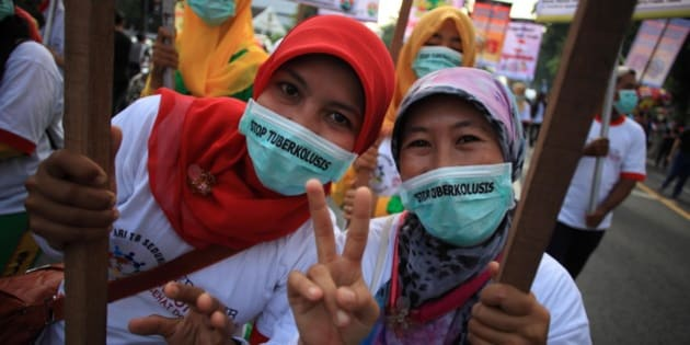 SURAKARTA, INDONESIA - MARCH 22: Activists hold banners during a rally marking the World Tuberculosis Day on March 22, 2015 in Surakarta, Indonesia.   Tuberculosis is an infectious disease caused by the Mycobacterium tuberculosis. It is the second most deadly disease in the world after HIV / AIDS. These bacterias spread through water particles in the air that move because of cough, sneeze, or spit.   PHOTOGRAPH BY Solo Imaji / Barcroft Media (Photo credit should read Solo Imaji / Barcroft Media via Getty Images)