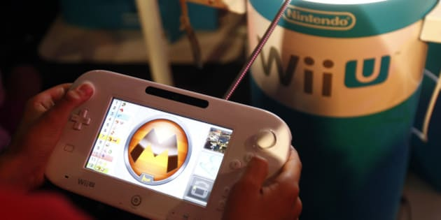 PARIS, FRANCE - OCTOBER 29:  A gamer plays the video game 'Mario Kart 8' developed by Nintendo EAD on a games console Nintendo Wii U at Paris Games Week, a trade fair for video games on October 29, 2015 in Paris, France. Paris Games week runs from October 28 until November 1, 2015.  (Photo by Chesnot/Getty Images)