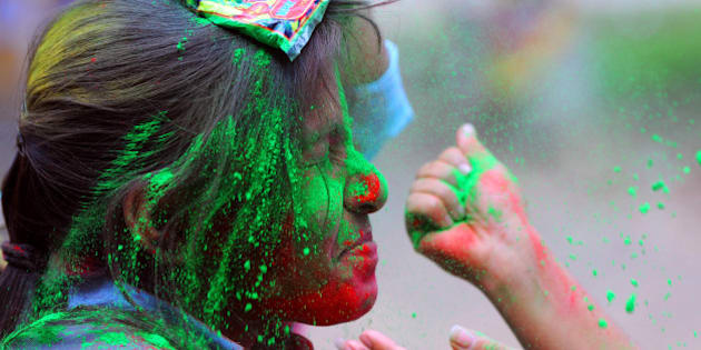 RANCHI, INDIA - MARCH 19: Students exchanging dry colours with each other before the Holi festival at Women's College campus on March 19, 2016 in Ranchi, India. Holi is a festival of colours, celebrated primarily in India. The festival falls on the last full moon day of Falgun according to Hindu calendar. It is celebrated sometimes in the month of March, usually in the latter half of the month. According to mythology, the festival celebrates the killing Holika, the sister of Hrinyakashyapu. The festival also holds significance with respect to end of winter season and the onset of summer season. (Photo by Parwaz Khan/Hindustan Times via Getty Images)