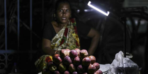 Assorted fruit sits under a light at a stall in a vegetable market in Vijayawada, Andhra Pradesh, India, on Monday, Oct. 12, 2015. Quelling food costs is critical for the government's popular support amid an election in Bihar state, as well as its goal of keeping overall inflation in check in a nation where about 277 million people live on less than $1.9 per day. Photographer: Dhiraj Singh/Bloomberg via Getty Images