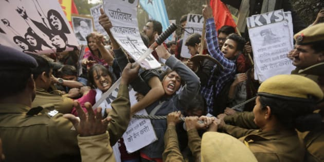 Policemen try to stop Indian students as they march towards the office of Hindu nationalist Rashtriya Swayamsevak Sangh (RSS) or the National Volunteers Association's office during a protest against the death of 26-year-old doctoral student Rohith Vemula in New Delhi, India, Saturday, Jan. 30, 2016. Saturday marked the birthday of Vemula whose body was found hanging in a hostel room, on January 17 weeks after he along with four others, was barred from using some facilities at his university in the southern tech-hub of Hyderabad.(AP Photo/Altaf Qadri)