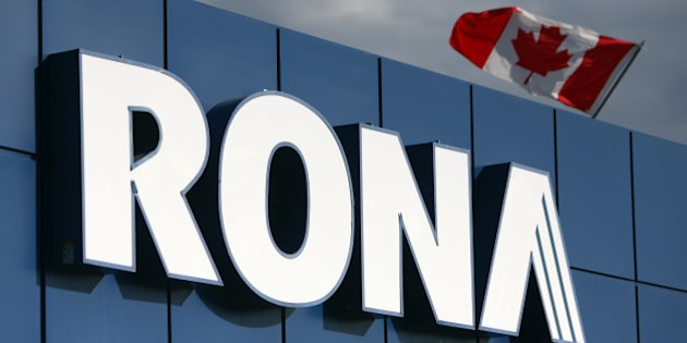A Canadian flag flies over Rona Inc. signage displayed at the company's store in Toronto, Ontario, Canada, on Feb. 3, 2016. Lowe's Cos. agreed to buy rival Rona for C$3.2 billion ($2.3 billion) in cash to create one of Canada's biggest home-improvement retailers, almost four years after its earlier takeover proposal got rebuffed. Photographer: Cole Burston/Bloomberg via Getty Images