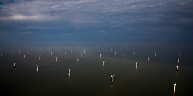 Wind turbines sit in the North Sea at the London Array offshore wind farm, a partnership between Dong Energy A/S, E.ON AG and Abu Dhabi-based Masdar, in the Thames Estuary, U.K., on Tuesday, Oct. 27, 2015. The London Array, east of London, has 175 Siemens turbines and a capacity of 630MW. Photographer: Simon Dawson/Bloomberg via Getty Images