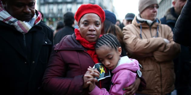 BRUSSELS, BELGIUM - MARCH 22:  A woman and a young girl embrace as people gather to leave tributes at the Place de la Bourse following today's attacks on March 22, 2016 in Brussels, Belgium. At least 31 people are thought to have been killed after Brussels airport and a Metro station were targeted by explosions. The attacks come just days after a key suspect in the Paris attacks, Salah Abdeslam, was captured in Brussels.  (Photo by Carl Court/Getty Images)