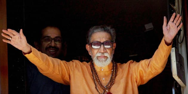 FILE- In this Jan 23, 2011 file photo, Hindu hardline Shiv Sena party leader Bal Thackeray waves at party workers gathered outside his residence on his 85th birthday in Mumbai, India. Thackeray, the extremist leader linked to waves of mob violence against Muslims and migrant workers, has died Saturday, Nov. 17, 2012, after ailing for several weeks. He was 86. (AP Photo)