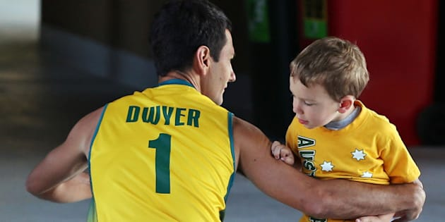 MELBOURNE, AUSTRALIA - DECEMBER 02:  Jamie Dwyer of Australia says goodbye too his son Julian Dwyer before his match during day two of the Champions Trophy on December 2, 2012 in Melbourne, Australia.  (Photo by Michael Dodge/Getty Images)