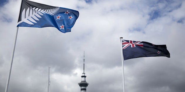 The existing New Zealand flag, right, flies alongside an alternative flag design as the Sky Tower, center, stands in Auckland, New Zealand, on Wednesday, March 2, 2016. New Zealanders will vote in a change-of-flag referendum from March 3-24 on whether to adopt a new design. Photographer: Brendon O'Hagan/Bloomberg via Getty Images