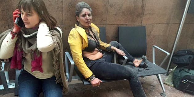 ADDS NAME AND DETAILS OF THE WOMAN AT RIGHT: In this photo provided by Georgian Public Broadcaster and photographed by Ketevan Kardava, Nidhi Chaphekar, a 40-year-old Jet Airways flight attendant from Mumbai, right, and another unidentified woman after being wounded in Brussels Airport in Brussels, Belgium, after explosions were heard Tuesday, March 22, 2016. A developing situation left at least one person and possibly more dead in explosions that ripped through the departure hall at Brussels airport Tuesday, police said. All flights were canceled, arriving planes were being diverted and Belgium's terror alert level was raised to maximum, officials said. (Ketevan Kardava/ Georgian Public Broadcaster via AP)