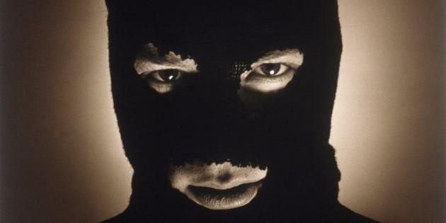 A portrait of a man with a ski mask