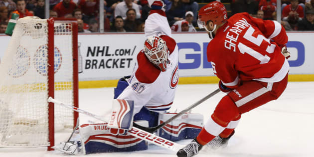 Detroit Red Wings center Riley Sheahan (15) scores on Montreal Canadiens goalie Ben Scrivens (40) in the second period of an NHL hockey game Thursday, March 24, 2016 in Detroit. (AP Photo/Paul Sancya)