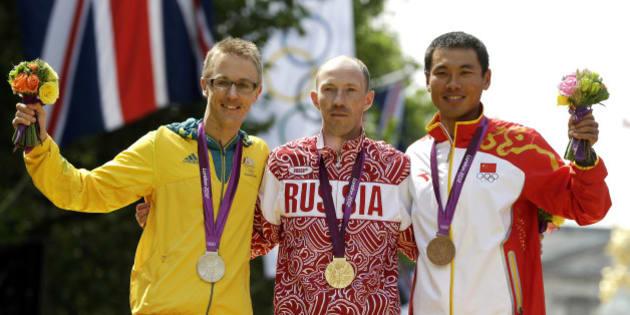 Gold-medallist Sergey Kirdyapkin of Russia, center, stands with silver-medallist Jared Tallent of Australia, left, and bronze-medallist Si Tianfeng of China after the men's 50-kilometer race walk competition at the 2012 Summer Olympics, Saturday, Aug. 11, 2012, in London. (AP Photo/Mike Groll)