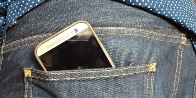 Htc mobile phone in jeans back pocket