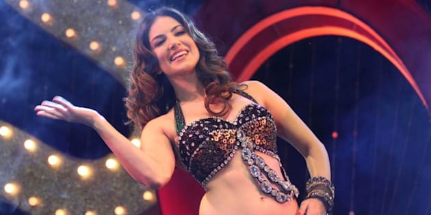 Adult film star Sunny Leone performs during a promotional event for the upcoming movie 'Shootout At Wadala' in Ahmadabad, India, Friday, April 26, 2013. The film based on growth of organized crime in late 70's and early 80's of Mumbai will be released on May 3, according to a press release. (AP Photo/Ajit Solanki)