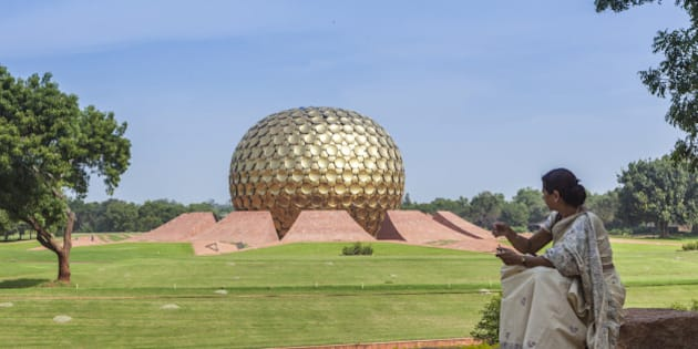 Auroville (City of Dawn) is an experimental township in Viluppuram district in the state of Tamil Nadu, India, near Puducherry in South India. The Matrimandir, a golden metallic sphere in the center of town.