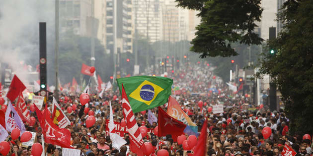 Demonstrators attend a protest in support of Brazil's President Dilma Rousseff and former President Luiz Inacio Lula da Silva, in Sao Paulo, Brazil, Friday, March 18, 2016. Supporters of Silva, who was one of the world's most famous leaders as president from 2003 to 2010, gathered for rallies in a handful of cities across Brazil, particularly in the industrial south, where the former factory worker has his base. Silva has been tied to a sprawling corruption investigation involving the Brazil oil giant Petrobras. (AP Photo/Andre Penner)