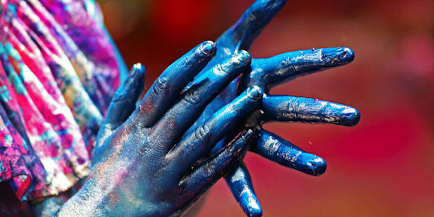 Shot during Holi festival in Old Dhaka, Bangladesh. Girl was coloring her hand, so she can paint other people.