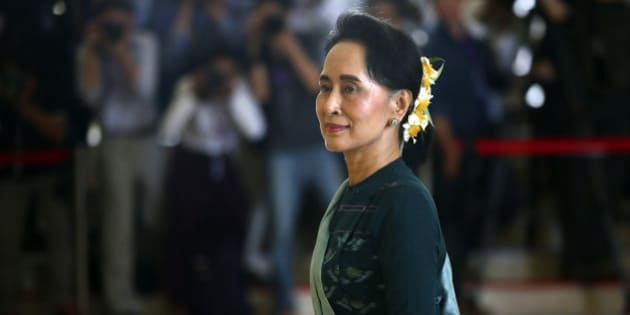 National League for Democracy party (NLD) leader Aung San Suu Kyi arrives in Manama's parliament in Naypyitaw, Myanmar, Tuesday, March 15, 2016. Myanmar's parliament votes Tuesday to pick the country's next president from a group of three final candidates, including a front runner who is a longtime confidant of Nobel laureate Suu Kyi. (AP Photo/Gemunu Amarasinghe)