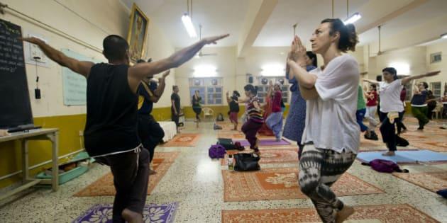 MUMBAI, INDIA  JUNE 16: Yoga Studio offering regular yoga classes for the benefit of their members at Santacruz on June 16, 2015 in Mumbai, India. (Photo by Pradeep Gaur/Mint via Getty Images)